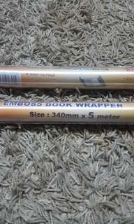 Emboss book wrapper