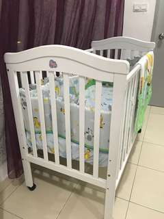 Sweet Cherry brand wooden baby cot