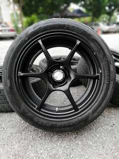 Black racing 15 inch sports rim saga flx tyre 70%. *offer mora mora*