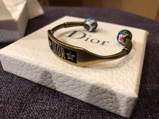 Dior metal brass bangle with unique artistic beads. Bought in May 2018 at Dior store in Landmark. Original price at HKD 3xxx. Brand new unworn.