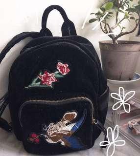 Velvet patched backpack