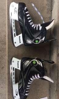 Black-and-white bauer ice hockey skates