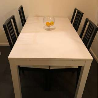 White extendable dining table.