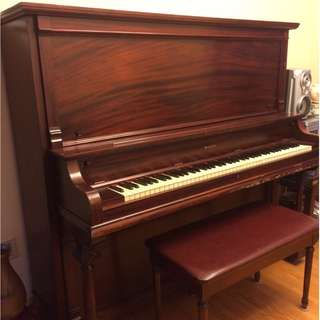 Upright piano with seat bench included
