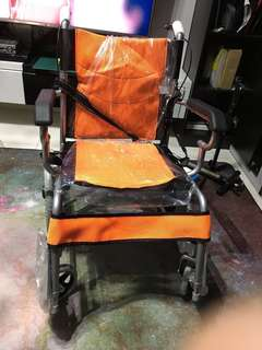 Brand New Orange Wheel Chair - new stock - le Long for 1 week