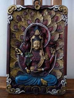 Wooden guan yin board