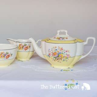 Pretty lemon yellow English teapot with matching creamer, in time for summer