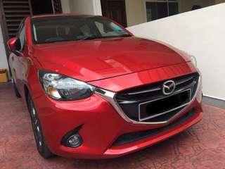 Red Mazda 2