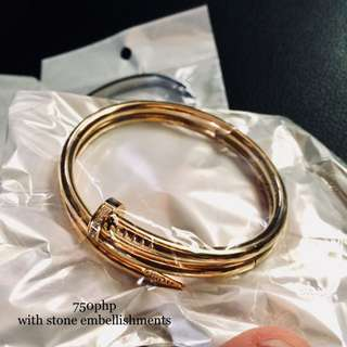 Cartier Nail gold bangle with stone embellishments