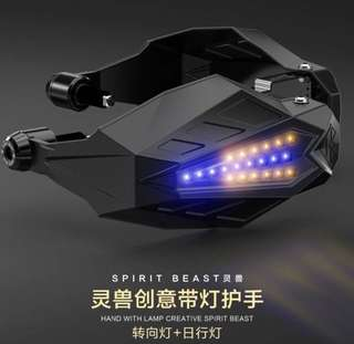 LED handguard with daytime running lights and turn signal