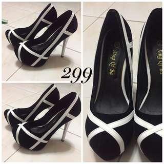 Black and white high heel
