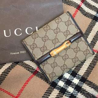 gucci wallet not lv louis vuitton ferragamo prada rolex