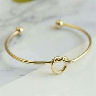 Tie Knot Gold Bangle