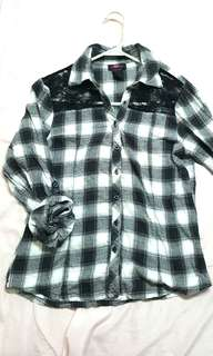 Black and white checkered polo