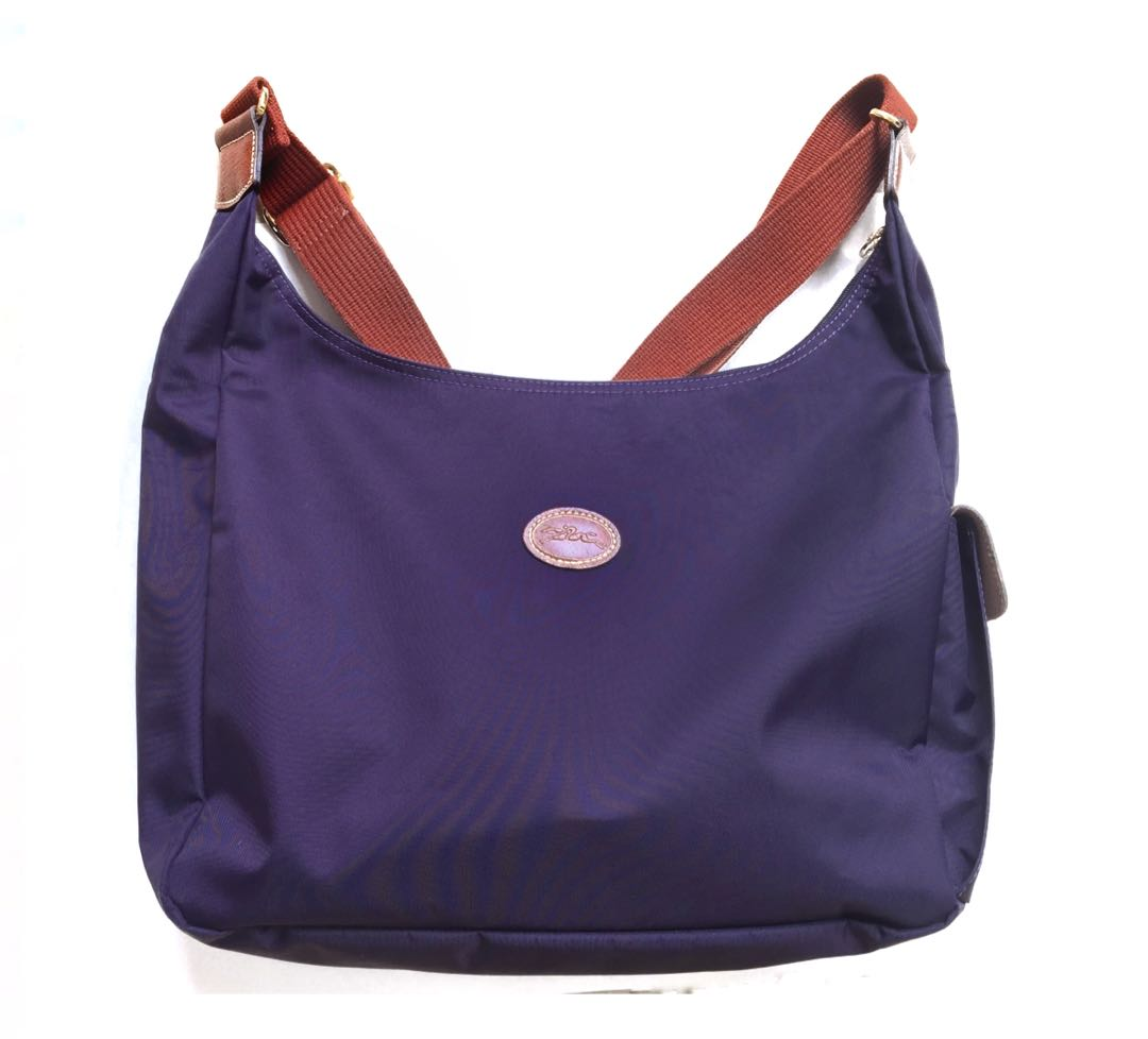 8a9126b3274b8 Authentic Longchamp Purple Sling Bag