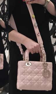 Pink quilted sling bag