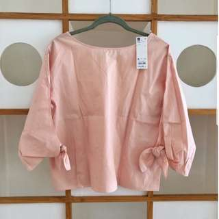 GU oversized pink top