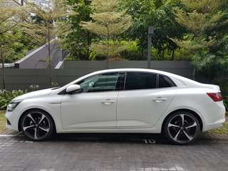 White Renault Megane Sedan