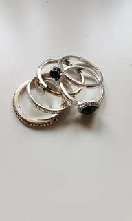 good used condition 5 piece silvertone ring set