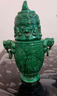 Green vase with lid