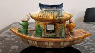Antique ceramic boat with men