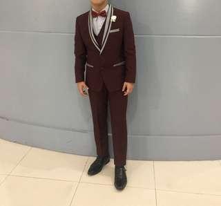 Dark maroon suit