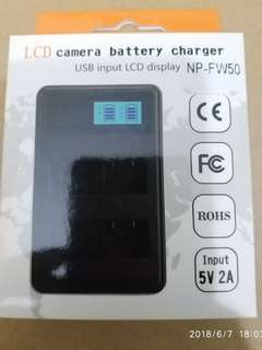 Sony NP-FW50 camera batteries (2) and charger