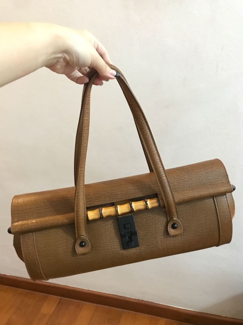 46f7f80a5e5 Authentic Gucci bamboo bullet bag in leather