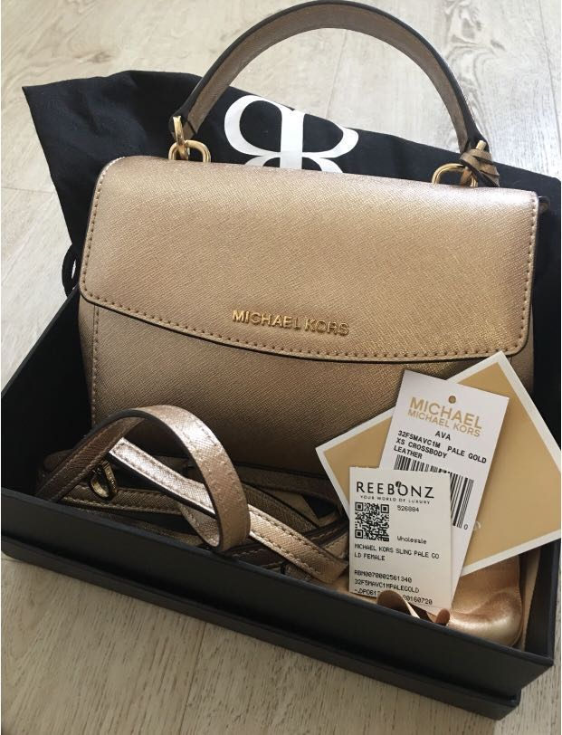 0f2abcc16a PRICED REDUCED  Michael Kors Ava XS pale gold