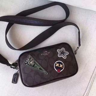 Coach crossbody pouch in signature coated canvas with varsity patches