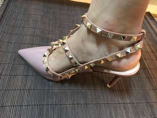 Pink high heels with gold pins