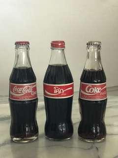 Thai and Indonesian Coke Bottles