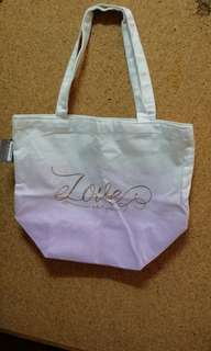 Cloth bag with LOVE what you do label
