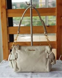 Authentic Miu Miu Cream Bow Baguette Miu Miu handbag