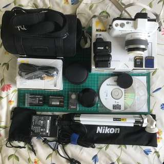 Like New: Nikon 1 V1 HD Digital Camera System with 10-30mm VR 1 NIKKOR Lense and Flash Kit (White)
