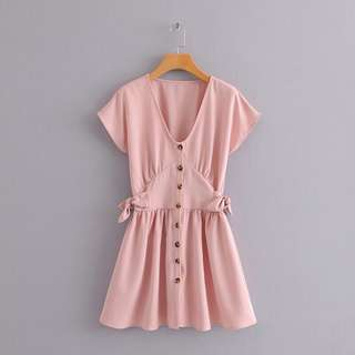 Pastel pink buttoned mini dress with bow