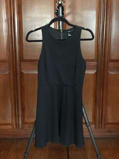 Black sleeveless dress with zipper