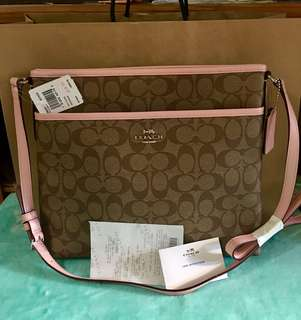 COACH File Bag. color baby pink.💯Original bought in 🇺🇸outlet.Complete inclusion with gift receipt tag price and care card. wla pong paper bag hnd kc ngbibigay ang coach outlet in every bag. hnd generous like in MK..wrapped ko nlng s bubble plstic😊