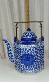 Porcelain  hand made water jug with thick brass handle