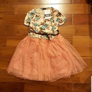 Peach tutu dress bunga