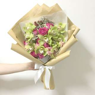 Green Cymbidium with hot pink roses and mix fillers in kraft paper / proposal bouquet / anniversary bouquet