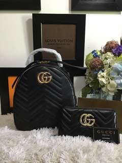 Gucci backpack with Gucci wallet
