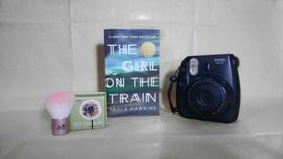 The Girl On The Train by Paula Hawkins (pocketbook size)
