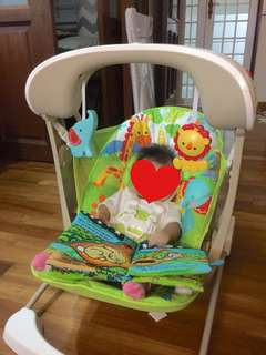 Slightly used Fisher Price Rainforest Take Along 2-in-1 Swing And Seat Rocker