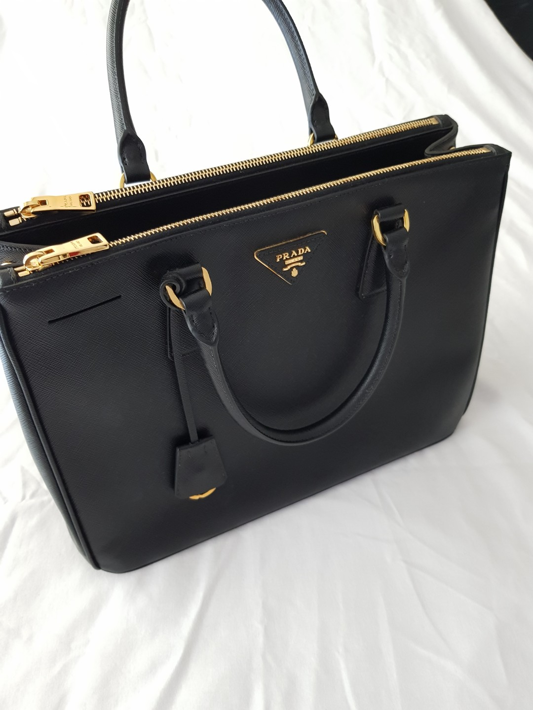 5af85bf210ec ... spain prada saffiano lux tote bag medium like new preloved womens  fashion bags wallets on carousell