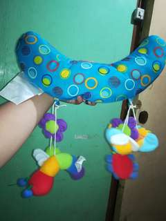 Pillow where you can hang toys to play with