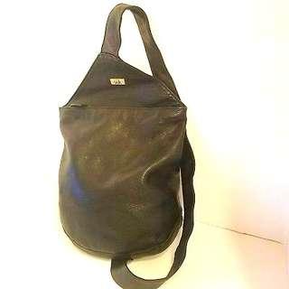 The Sak black leather sling backpack