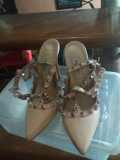 Pre-loved luxury branded shoes