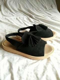 Black tassel platform sandals