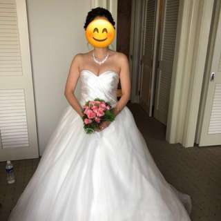 Heart shaped wedding gown with long train